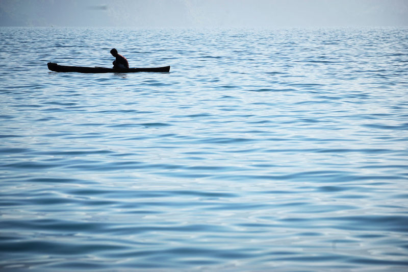 Sumatra  Toba Lake Adult Beauty In Nature Day Nature Nautical Vessel Oar One Person Outdoors Paddleboarding People Rowing Sea Water