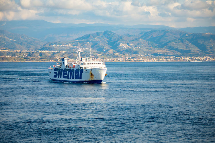 Messina Italy Sicily Ferry Sea Nautical Vessel Transportation Cloud - Sky Mode Of Transportation Water Mountain Sky Waterfront Nature Scenics - Nature Travel Craft Sailing Beauty In Nature Mountain Range Ship Day No People Outdoors Passenger Craft Cruise Ship