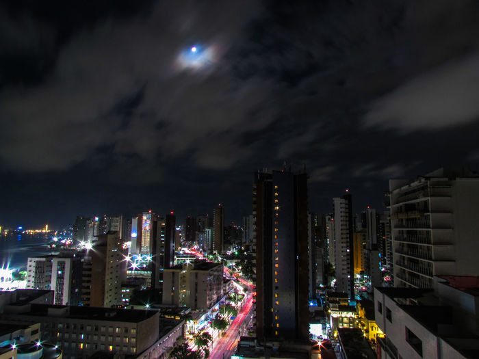 HUAWEI Photo Award: After Dark Architecture Building Building Exterior Built Structure City City Life Cityscape Cloud - Sky Financial District  Illuminated Modern Moon Nature Night No People Office Office Building Exterior Outdoors Road Sky Skyscraper Tall - High Capture Tomorrow