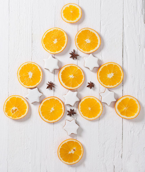 A Christmas tree made of Oranges, cinnamon starts and clove Christmas Christmas Tree Christmastime Cinnamon Cinnamon Stars Citrus Fruit Clove Cross Section Food Food And Drink Fruit Halved High Angle View Indoors  No People Orange - Fruit SLICE