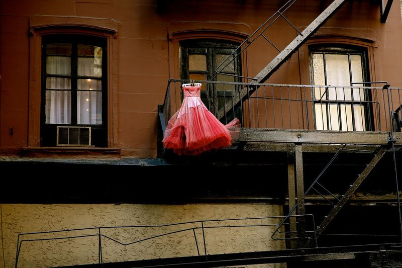 Brown Stone Creatvie Dress Fire Escape Gown Lower West Sid New York City Painting On The Side Of A Building Pink Dress Unexpected Unusual Unusual Beauty Unusual Find Urban Beauty West Side West Side Story Wind