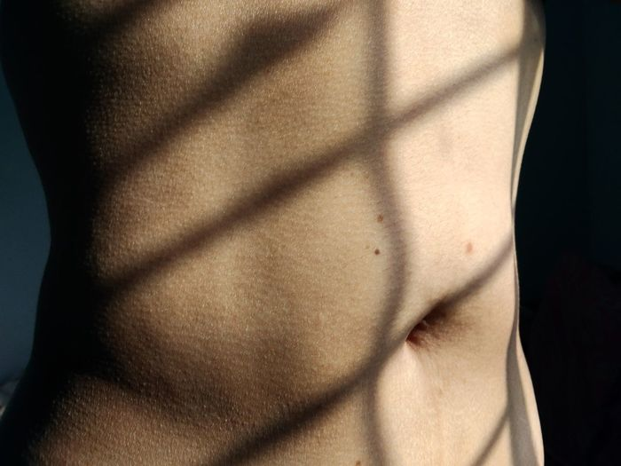 Shadow Human Skin Women Standing Midsection Textured  Close-up Belly Button Stomach Belly Focus On Shadow Long Shadow - Shadow Human Abdomen Abdomen Skin Human Fertility Hands On Stomach