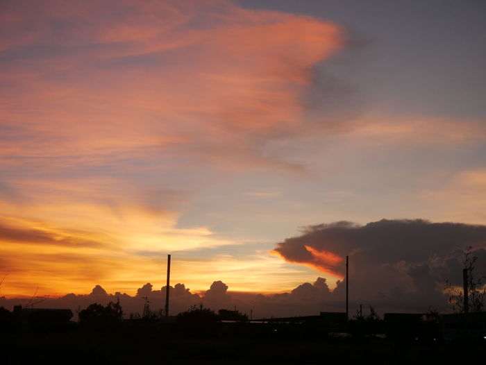 silhouette landscape Air Pollution Architecture Beauty In Nature Building Exterior Built Structure Cloud - Sky Dramatic Sky Environment Factory Industry Nature No People Orange Color Outdoors Pollution Scenics - Nature Silhouette Sky Smoke - Physical Structure Smoke Stack Sunset