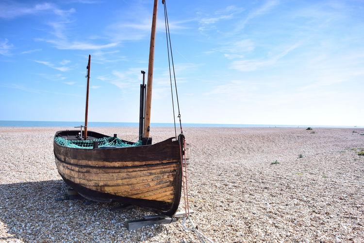 Wooden boat on sunny beach