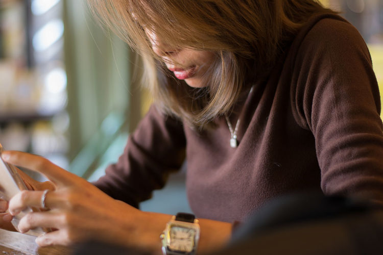 Close-up of woman using smart phone