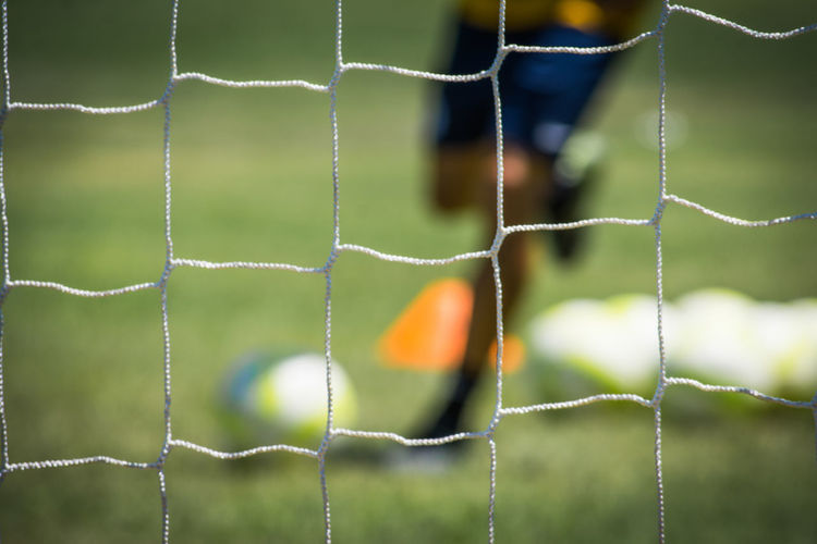 Beauty In Nature Close-up Coach Day Fence Focus On Foreground Football Fragility Full Frame Goal Green Color Lifestyles Nature No People Orange Color Outdoors Soccer Sport Training Tranquility Vibrant Color