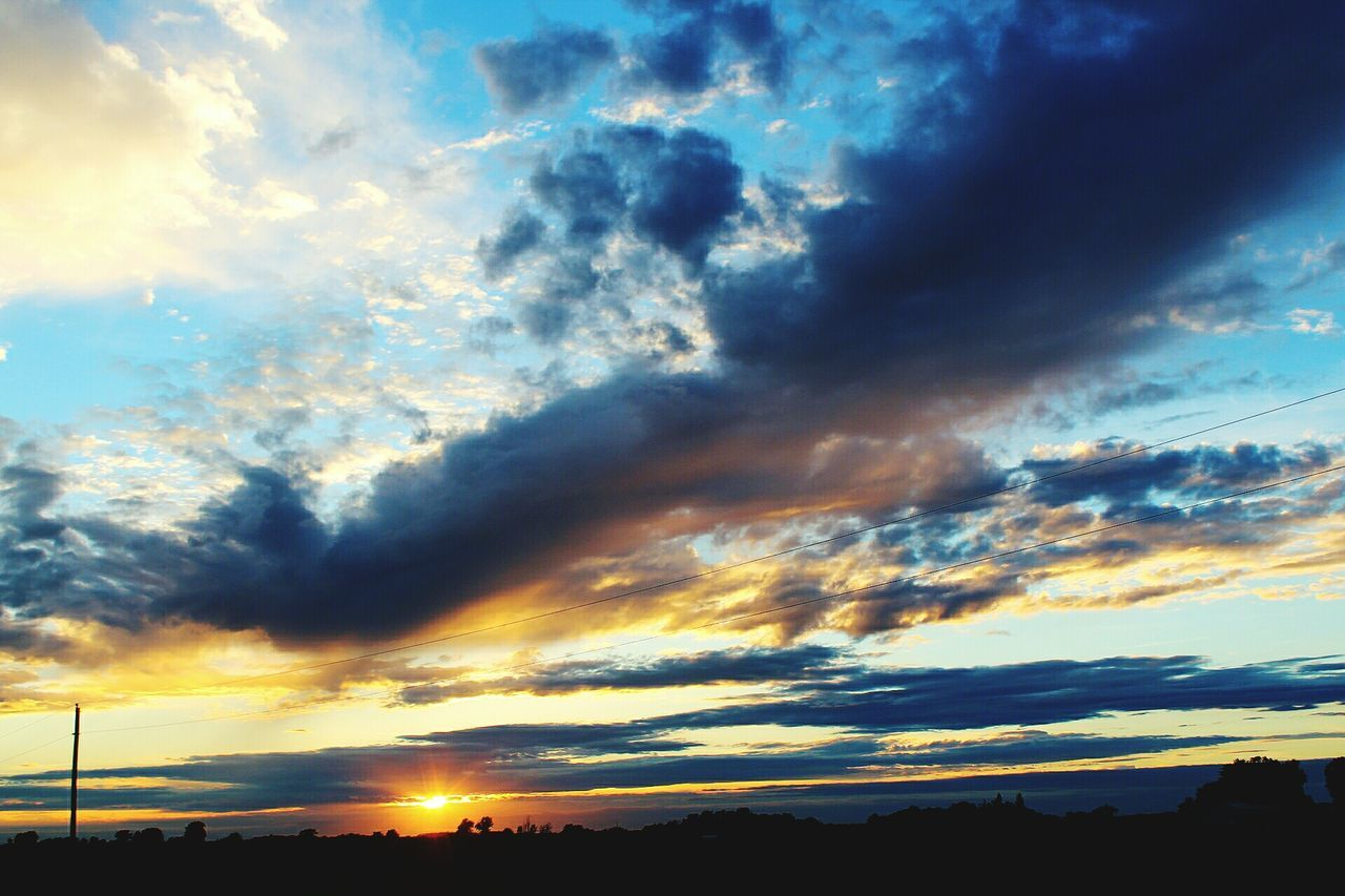 sky, cloud - sky, sunset, scenics, beauty in nature, silhouette, tranquil scene, tranquility, dramatic sky, nature, no people, low angle view, outdoors, day