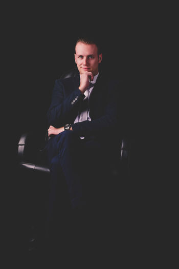 Black Background Business Business Person Businessman Copy Space Dark Formalwear Front View Handsome Indoors  Looking At Camera One Person Portrait Suit Three Quarter Length Well-dressed Young Adult Young Men