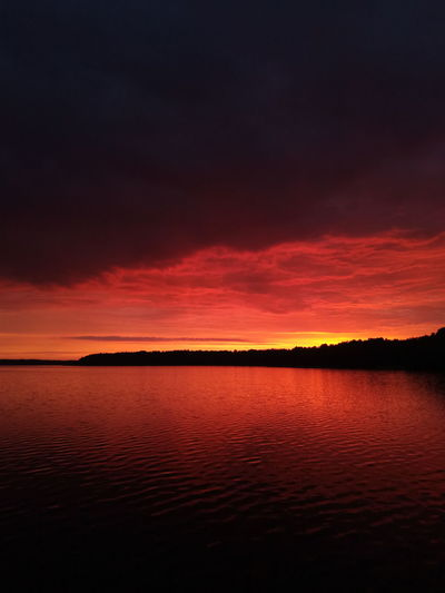 sunset Coloredclouds Tranquility Midnight Lakeshore Horizon Tone Shade Ripples Shadow Nightsky Water Sunset Sea Red Reflection Sky Horizon Over Water Landscape Romantic Sky Low Tide Dramatic Sky Seascape Silhouette Majestic Moody Sky Atmospheric Mood Orange Color Coast Headland Storm Cloud