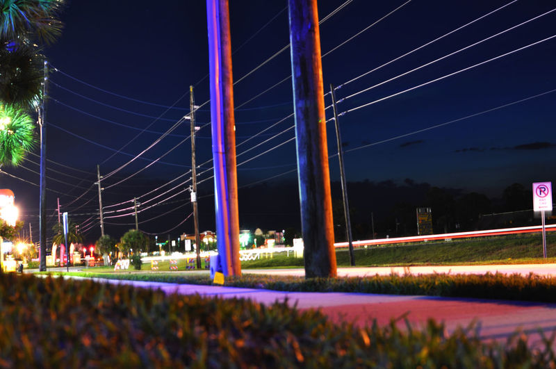 Long exposure at roadside in Florida Florida Grass Verge Light Trails Long Exposure Long Exposure Shot Night Night Lights Nightphotography Power Lines Road Road Sign Telegraph