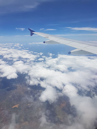 Aerial View Air Vehicle Airplane Airplane Wing Beauty In Nature Blue Cloud - Sky Day Flying Journey Nature No People Outdoors Scenics Sky The Natural World Tranquil Scene Tranquility Transportation Travel
