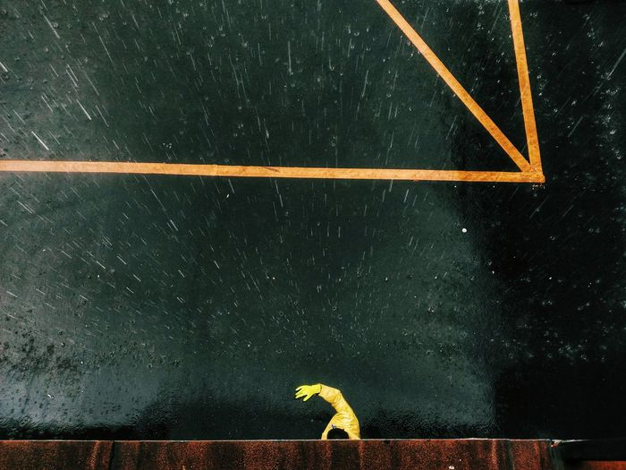 Full frame shot of water on yellow wall