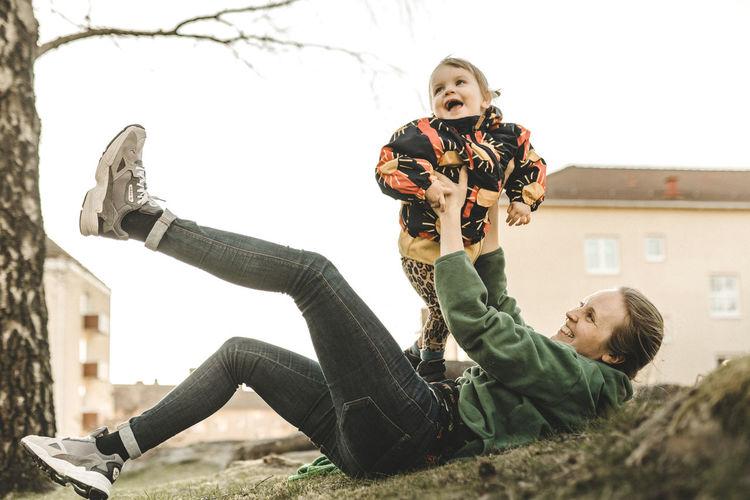 Full length of men holding boy