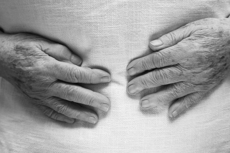 Hands of an old woman in a bed Adult Adults Only Affectionate Bonding Care Close-up Day Family Grandmother Hospital Human Body Part Human Finger Human Hand Human Skin Indoors  People Senior Adult Togetherness Touching Wrinkled