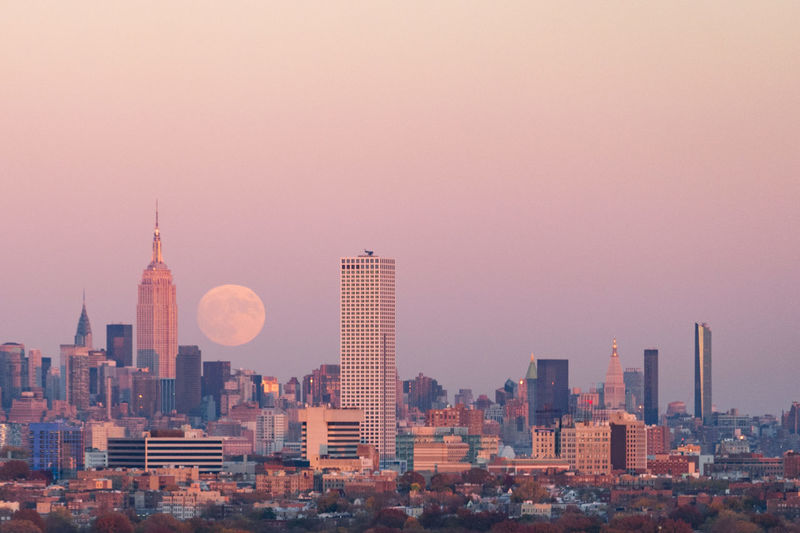 Architecture Building Exterior City Cityscape Fall Metropolis Moon Moonlight New York New York City No People Outdoors Sky Skyline Skyscraper Sunset Supermoon Urban Skyline