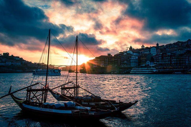 Sunset over Porto Bridge Architecture Moored Water Mast Boat Sunset Outdoors Travel Destinations Tranquility Scenics