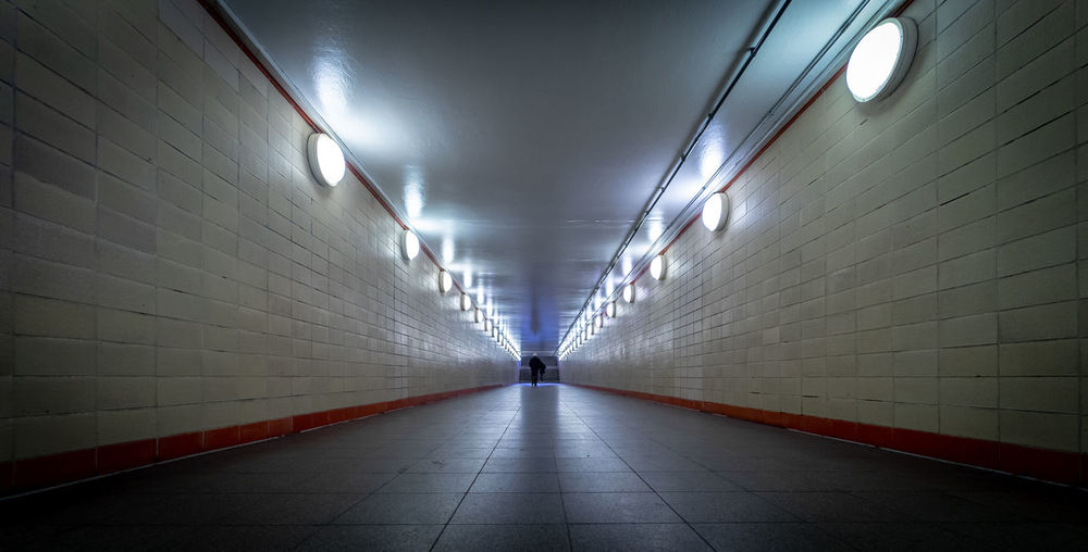 Futuristic Subway Station Tunnel Reflection Illuminated Direction The Way Forward Lighting Equipment Architecture Indoors  Diminishing Perspective Transportation Wall - Building Feature Built Structure Footpath Flooring Ceiling Public Transportation Subway Tile Wall Empty Underground Walkway No People Light Underpass Tiled Floor Light At The End Of The Tunnel