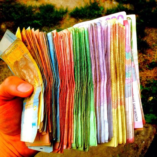 Multi Colored Holding Retail  Person Sale Business One Person Human Body Part Freshness Close-up Day Outdoors Horizontal People Money Grivnya