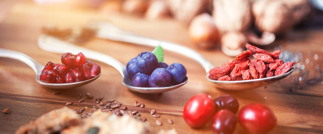 High angle view of fruits and seeds on wooden table