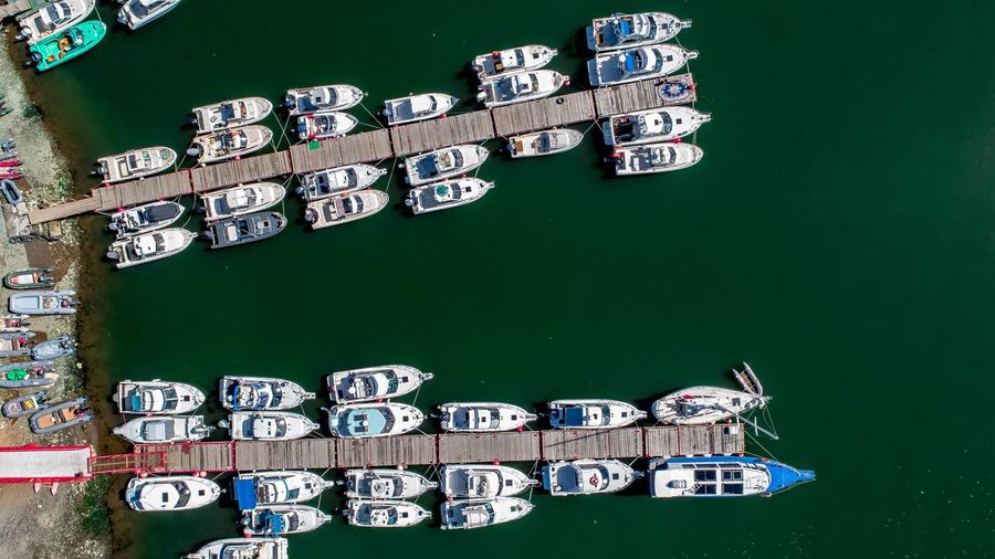 Directly above shot of yachts moored at piers on river