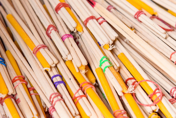 Close-up of candles and incense sticks for sale at market stall
