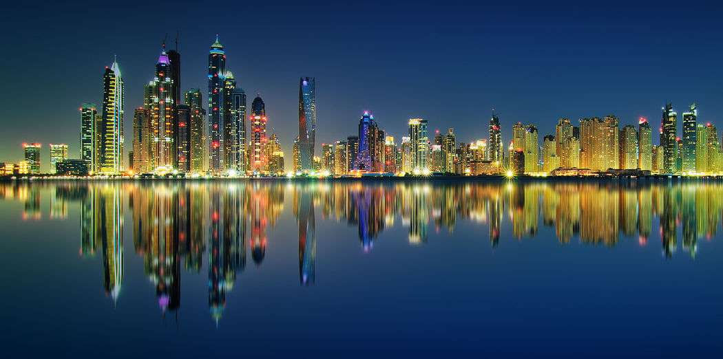 Amazing night panorama reflection of Jumeirah Beach, Dubai, United Arab Emirates Dubai United Arab Emirates Architecture Building Building Exterior Built Structure City Cityscape Downtown District Financial District  Illuminated Landscape Modern Nature Office Building Exterior Outdoors Purple Reflection Skyscraper Spire  Tall - High Tower Urban Skyline Water Waterfront