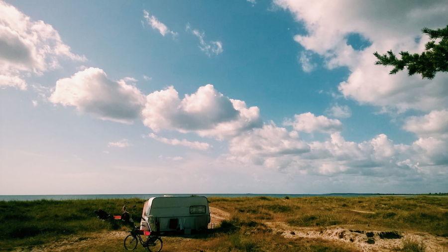 Travel Trailer On Field Against Sky