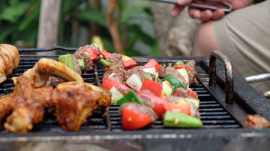 Bbq Meats Food And Drink Food Barbecue Grilled Meat Barbecue Grill Freshness Skewer Outdoors Kebab Preparation  Healthy Eating Vegetable Day Serving Tongs Ready-to-eat Real People Close-up Summer Exploratorium Modern Hospitality