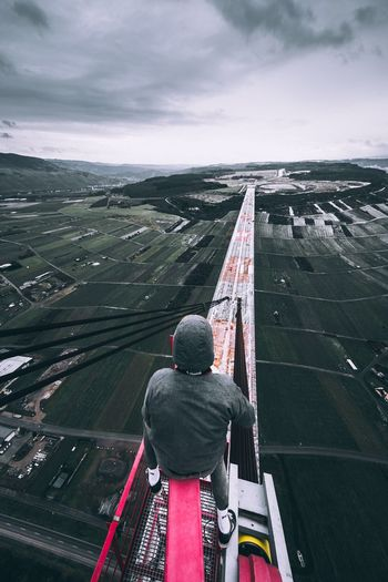 Road to Freedom Urbex Exploration Explore Fearless Visual Daredevil Freeclimb Urban Rooftopping Rear View Real People Cloud - Sky Sky Day Outdoors Men Lifestyles
