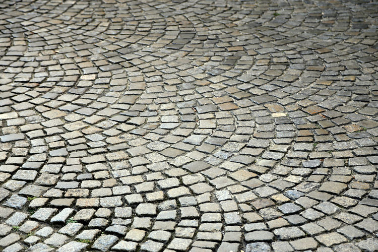 Cobblestone pattern with circles Circular Cooblestone Cobblestone Streets Cobbled Pavement Backgrounds Full Frame Pattern Textured  No People Day Nature Outdoors High Angle View Cobblestone Drought Solid Stone Material Street Field Abundance Footpath Architecture Sunlight Design Arid Climate Climate