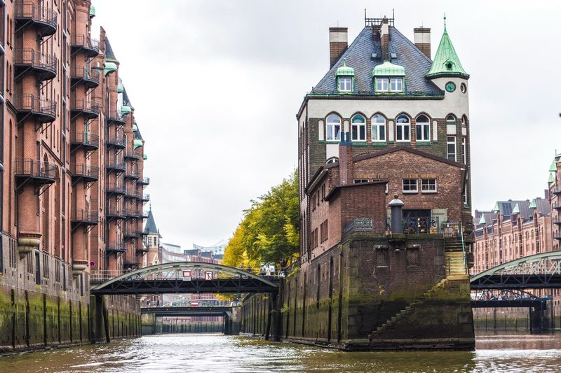 EyeEm Selects Architecture Built Structure Building Exterior Bridge - Man Made Structure Water Sky River Day No People City History Waterfront Outdoors Old Town Cloud - Sky Covered Bridge Travel Destinations Tree Low Angle View Built_Structure Wasserschloss Speicherstadt Hamburg Hamburg Germany