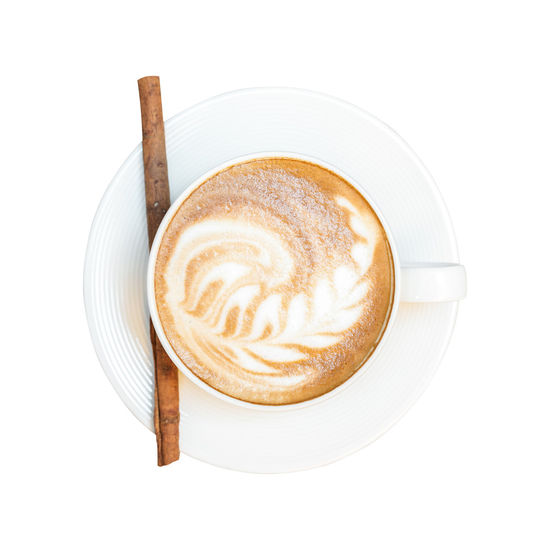 Directly above shot of cappuccino served on table against white background