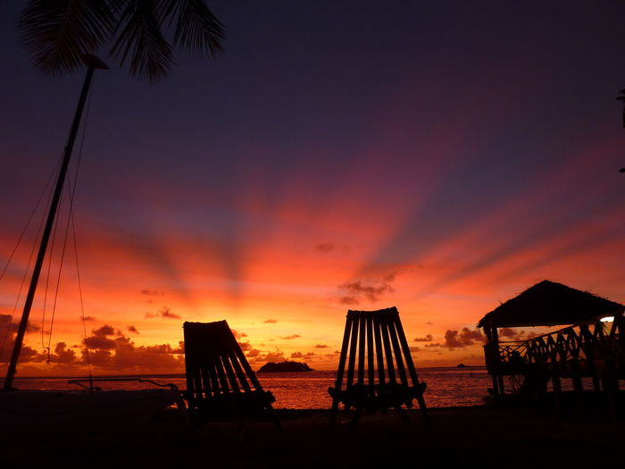 Fiji Tropical Paradise Tropical Island Sunset Sky Tranquil Scene Silhouette Tranquility Sea Land Nature Beach Orange Color Scenics - Nature Beauty In Nature Water Tropical Climate Idyllic Palm Tree Cloud - Sky No People Horizon Horizon Over Water Outdoors Palm Leaf