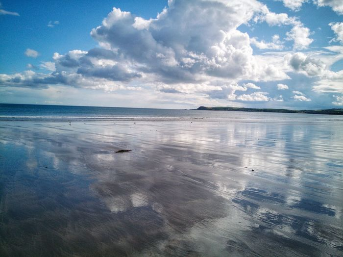 Shimmering view of Helvick Pinensula from Clonea Strand. Waterford Ireland🍀 Cloud - Sky Sea Water Tranquility Shimmering Refelections Horizon Over Water Scenics Tranquil Scene Beach Blue Sky Landscape Beauty In Nature Outdoors Nature Day EyeEmNewHere Huawei P10 Plus Coastal Beauty EyeEm Nature Lover Calm And Serene Calm Sea The Week On EyeEm Lost In The Landscape