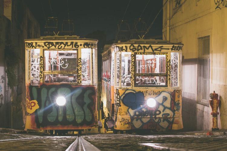 Graffiti on illuminated building