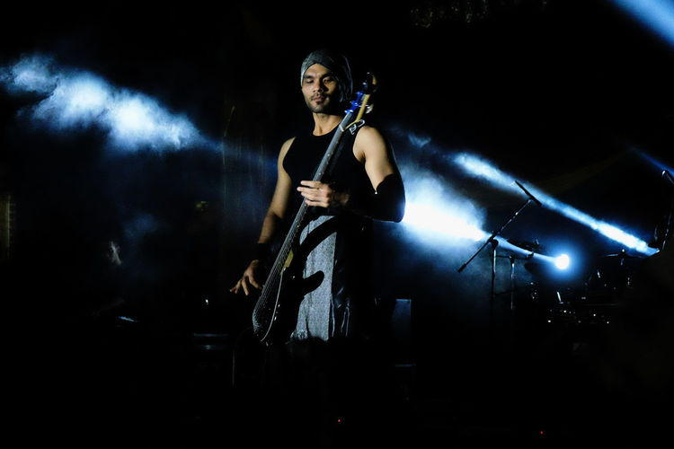 Bassist One Person Adults Only One Woman Only Performance People Stage - Performance Space Portrait Real People Night Performing Arts Event Stage Metal Band Festival Music Skill