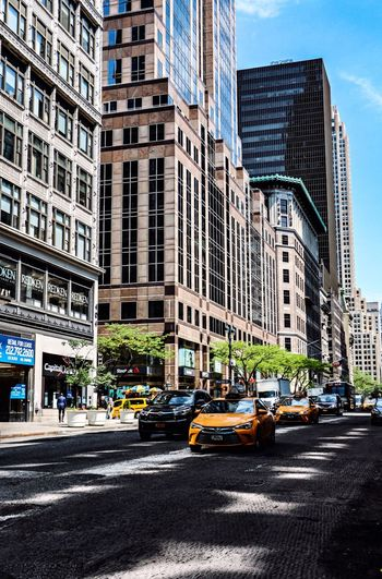City Architecture Building Exterior Street Built Structure Road City Life Travel Destinations Cityscape Taxi Office Building Exterior Car Transportation New York City New York USAtrip