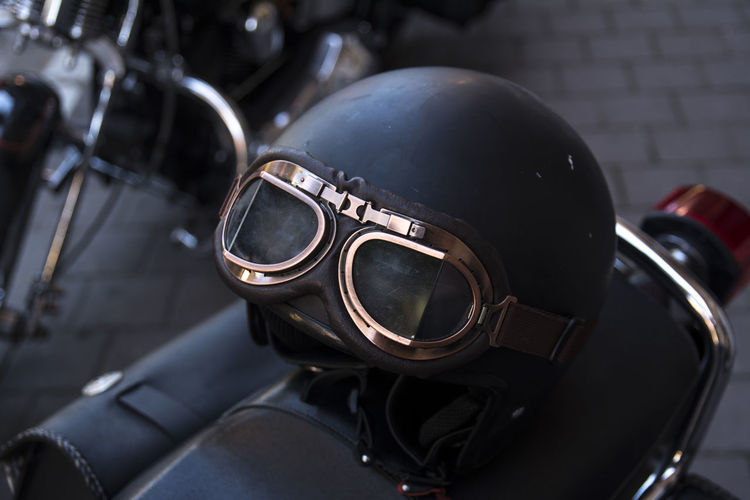 Security Motorcycle Close-up Safety Protection No People Focus On Foreground Metal Black Color Helmet Still Life Outdoors Day Mode Of Transportation Leather Mask High Angle View Land Vehicle Personal Accessory