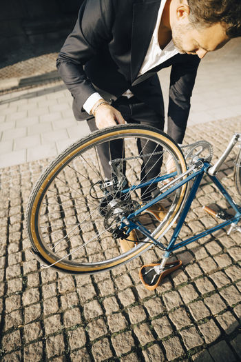 Man with bicycle on footpath