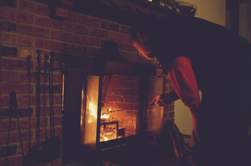 Man By Fireplace