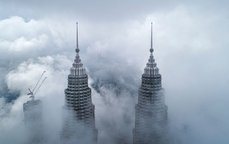 View of skyscrapers in foggy weather