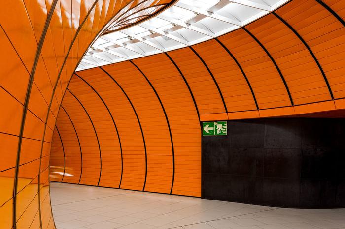 Munich Underground Underground Underground Station  Undergroundphotography Architecture Built Structure Corridor Day Illuminated Indoors  No People Orange Color Text