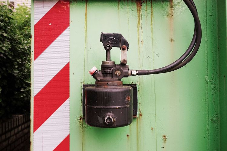 Container No People Close-up Day Metal Wall - Building Feature Outdoors Old Technology Connection Wall Weathered Red Safety Hanging Pipe - Tube Equipment Electricity  Machine Valve Green Color