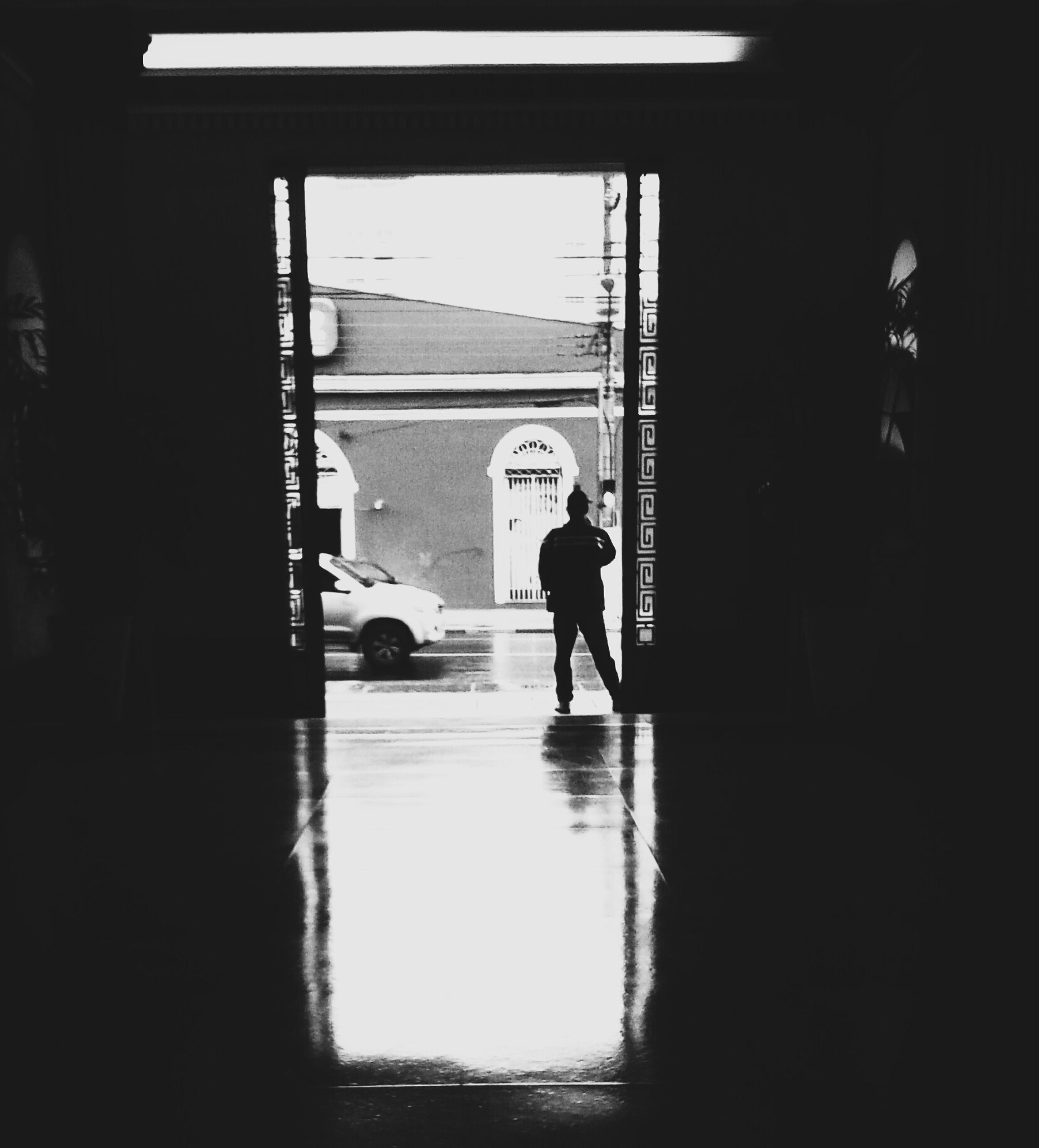 indoors, full length, architecture, silhouette, men, walking, built structure, lifestyles, window, rear view, leisure activity, person, standing, reflection, city life, day, shadow, sunlight
