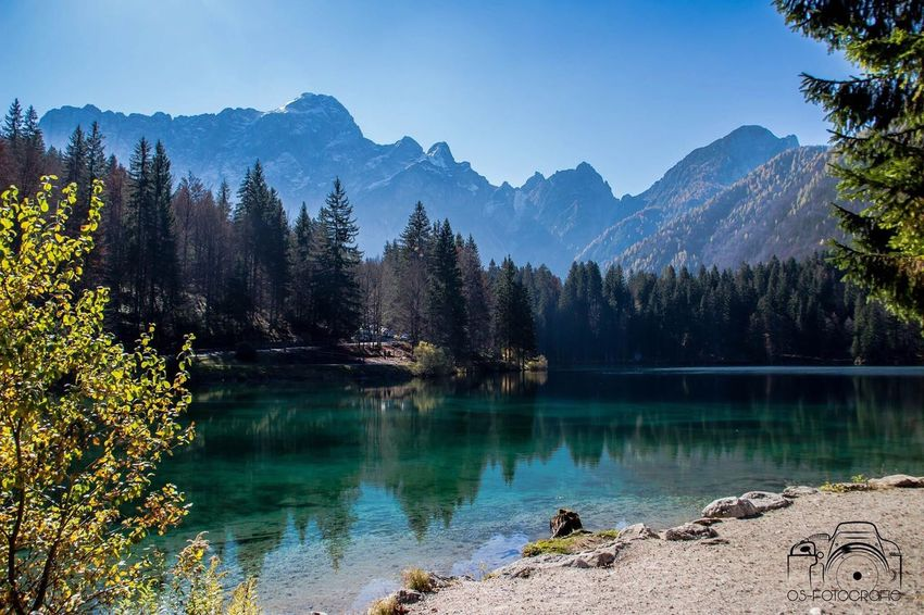 Tranquil Scene Tree Mountain Scenics Tranquility Lake Water Beauty In Nature Idyllic Majestic Nature Reflection Non-urban Scene Calm Mountain Range Blue Physical Geography Remote Pine Tree Mountain Peak