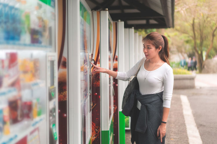 Woman using vending machine