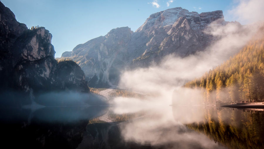 Misty mountains cold. Landscape Reflection Mountain Water Mountain Peak Lake Forest Scenics Fog Travel Destinations Nature Outdoors Day Braies Lake Trentino Alto Adige Trentino  Foggy Idyllic Silence Beauty In Nature