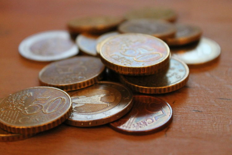 Close-up Coin Currency Day Finance Financial Item Indoors  Large Group Of Objects Metal Money No People Savings Table Wealth