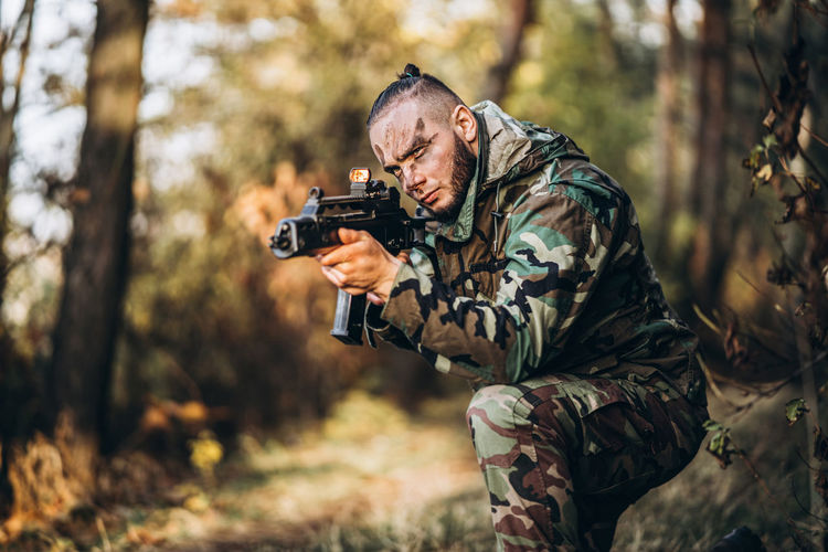 Man holding camera in forest