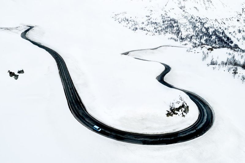 High Angle View Of Winding Road On Snowcapped Mountains